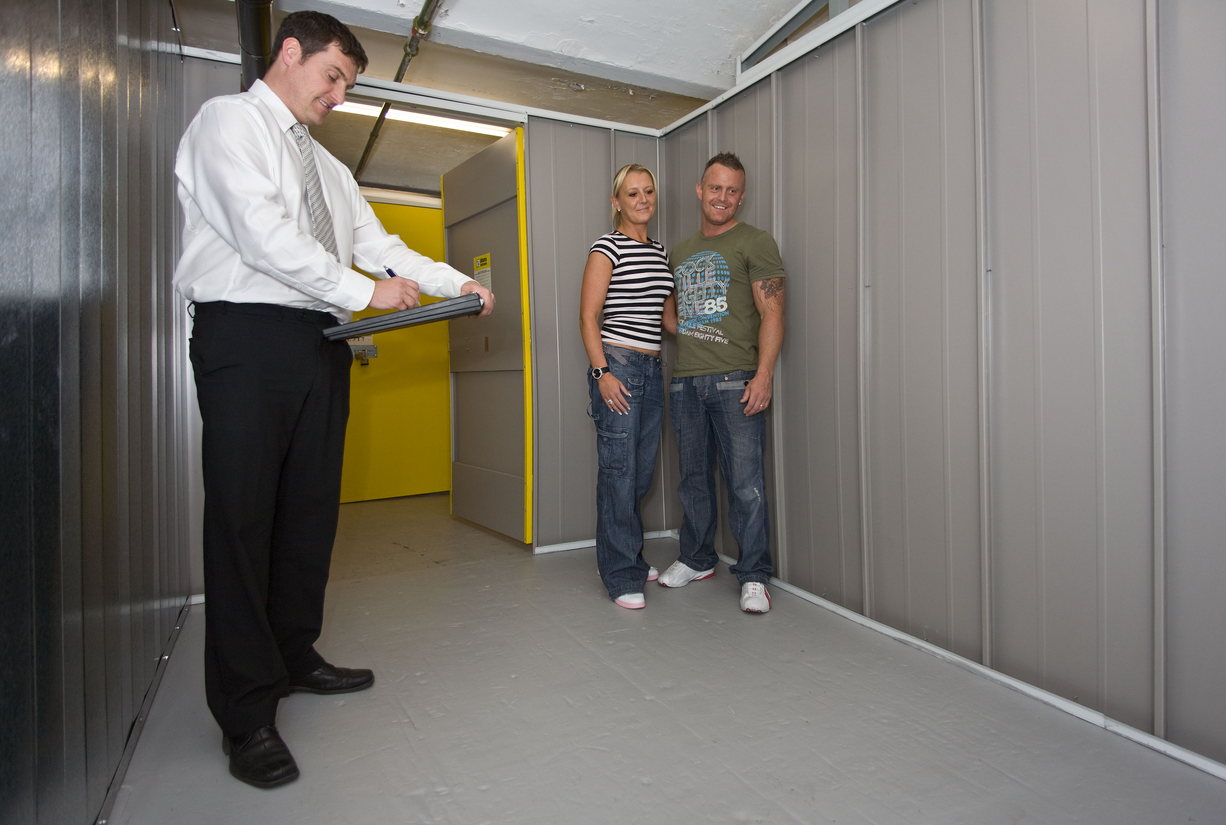 Couple viewing storage room.